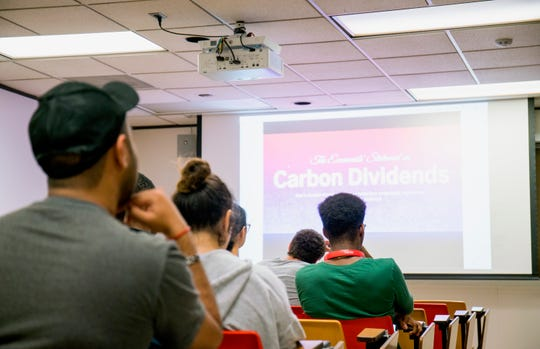 Students learn about carbon dividends. The Baker-Shultz Carbon Dividends plan has been proposed by a campaign of college republican leaders from across the U.S. as a market-based alternative to other carbon tax proposals.