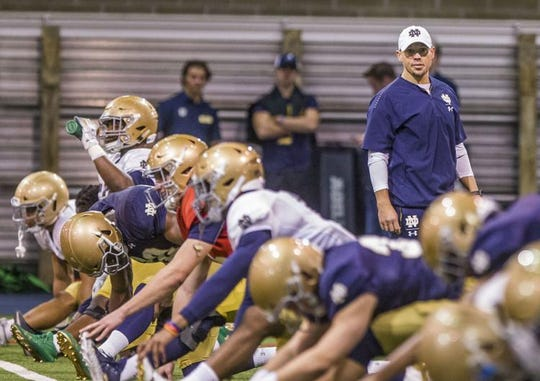 Brian Kelly likes the collaboration he has seen lately from his offensive coaches, including running backs coach Lance Taylor (pictured).