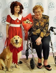 """Betty Osincup of Washington, who turned 100 last month, received flowers from lead actor Camila Koch during a recent performance of """"Annie"""" at the Coralville Center for the Performing Arts. At age 11, Betty and a friend sang the theme song live for the first season of the national """"Little Orphan Annie"""" radio show in Chicago."""