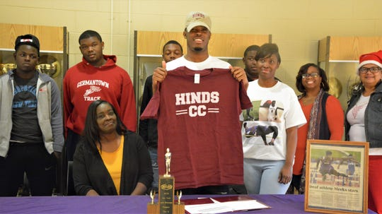 Former Mississippi School for the Deaf standout athlete Kenmarkis Meeks, center, signed a national letter of intent to run track at Hinds Community College on Thursday, December, 19, 2019.