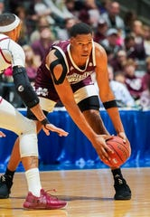Mississippi State's Robert Woodard II (12) sizes up the defense against New Mexico State on Dec. 22, 2019, at the Mississippi Coliseum in Jackson, Mississippi.
