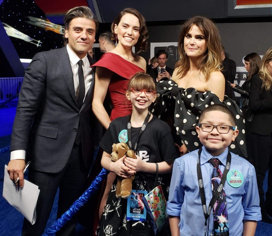 From left background: Oscar Issac, Daisy Ridley, and Keri Russell. From left foreground: Addisyn Richards and Ayden.