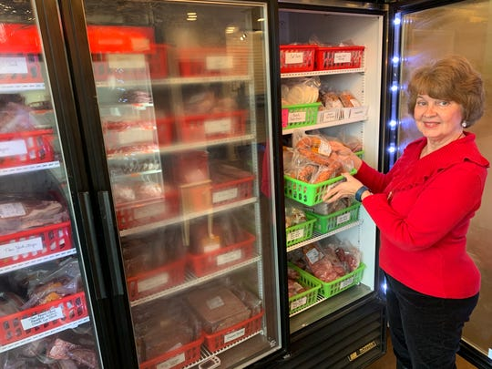 Brenda Smithers, an employee at the Remington-Lott Farms store in Ridgeland, checks products available for sale.