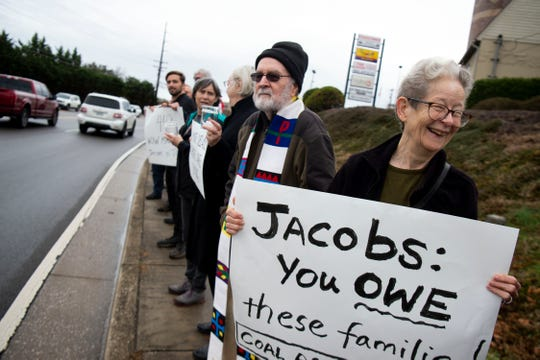 Fran Ansley of Jobs With Justice is one of over 50 people gathered along Northshore Dr. on Monday, December 23, 2019 to protest Jacobs Engineering. Jacobs Engineering, which has a local office nearby, is accused in lawsuits in U.S. District Court of failing to protect hundreds of workers who cleaned up the 2008 coal ash spill.