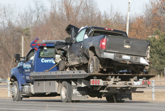 A pickup that crashed into a semi truck on U.S. 23 Monday, Dec. 23, 2019 is loaded onto a flatbed tow truck prior to removal from the scene.