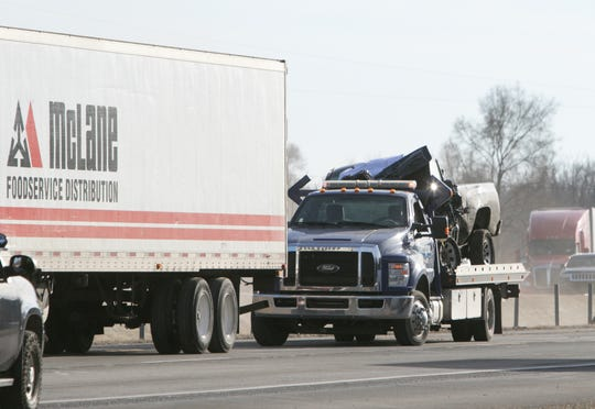 A semi-truck and a pickup truck crashed on U.S. 23 Monday, Dec. 23, 2019, causing the freeway to be closed for nearly five hours.