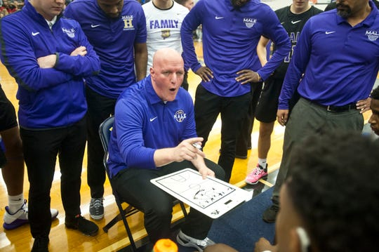 Male head basketball coach Tim Haworth talks to his players during a time-out in the semi-final game of the 39th annual King of the Bluegrass tournament. Dec. 22, 2019