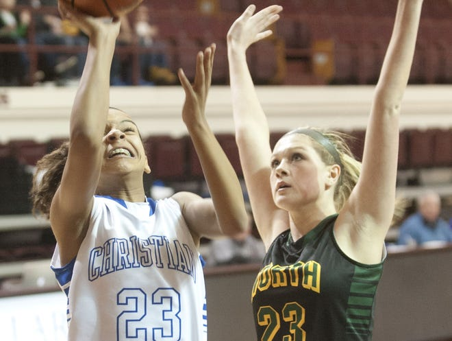 Shelby Calhoun, left, led the Christian Academy girls basketball team to the championship of the Traditional Bank Holiday Classic at Lexington Catholic on Monday.