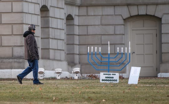 A small menorah placed by the Jewish organization the Chabad of Greater Lansing and Michigan State University, seen Monday, Dec. 23, 2019, on the Capitol lawn in downtown Lansing.