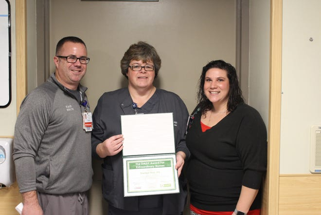 Charlie Hall, RN, (center) in the Emergency Room at McLaren Greater Lansing with her leaders Kevin Boggs, Manager of the Emergency Department, and Taryn Hull, Assistant Manager of the Emergency Department.