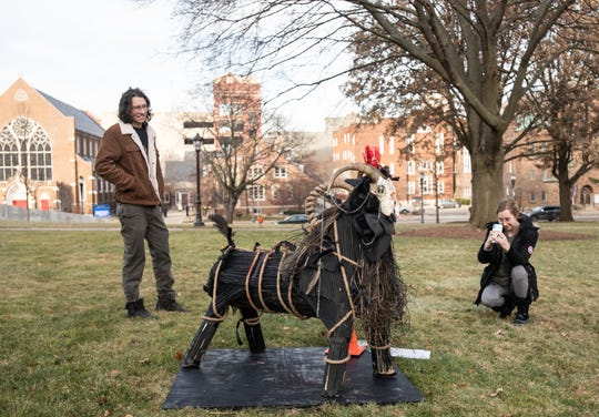 Terjae Maki, left, and Ivy Herron stop by the State Capitol Monday, Dec. 23, 2019, to check out the Yule goat on the Capitol lawn.  They had read about it online, and stopped by to take a picture of it.