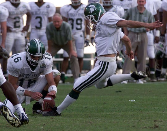 MSU's Paul Edinger sent Michigan State to a win over Florida in the 2000 Citrus Bowl with this kick, held by quarterback Bill Burke. .