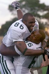 MSU's Gari Scott and Desmond Thomas celebrate their victory over Florida in the Citrus Bowl.