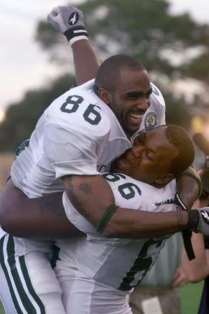 MSU's Gari Scott and Desmond Thomas celebrate their victory over Florida in the Citrus Bowl.