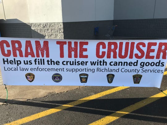 Donations were coming in quickly Monday outside Walmart in Ontario as area law enforcement organized a Cram the Cruiser fundraiser for local food pantries.