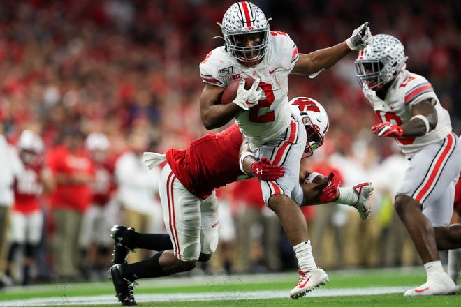 Santa Spence's wish is for J.K. Dobbins to break Archie Griffin's career rushing record at Ohio State. But it will mean coming back for his senior season to do it.