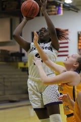 Lexington's Avery Coleman leads Lady Lex into battle against Norwalk at the Wayne Roller Holiday Showcase.