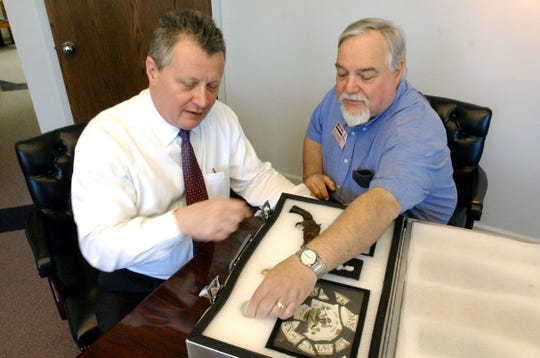 In this 2005 photo, Pink Palace museum executive Steve Pike and manager of collections Ron Brister look at artifacts found during excavation of the FedExForum. The Pink Palace celebrated its 75th anniversary that year.