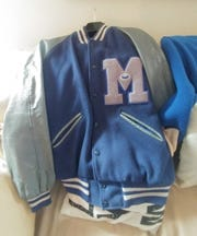The Memphis letterman jacket Memphis Tiger fan Chuck Neal recently gave back to the family of former Memphis State trainer J.D. Dickerson