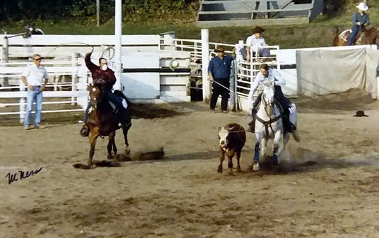 Chuck Newman, left, in the white medical mask, roping a steer in Sac City, Iowa, a couple months after his first transplant.