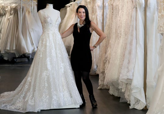 White Dress Off the Rack owner Christina Alexander Wegner stands in the assortment of bridal gowns available the store, 196 S. Second St. White Dress Off the Rack is focused on brides with limited time to plan and a smaller budget.