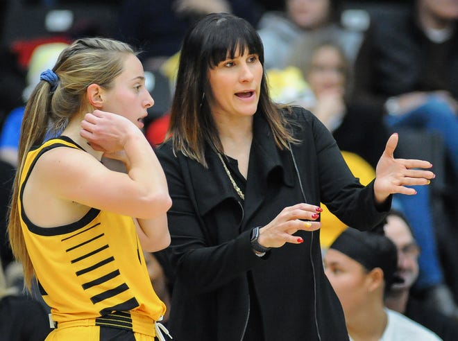 UW-Milwaukee  guard McKaela Schmelzer, shown in an earlier game with coach Kyle  Rechlicz, had 10 points and eight assists Friday night.