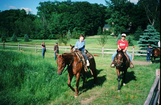 David Joyce and his brother riding horses with Chuck Newman and Shelly Strahl in the background.
