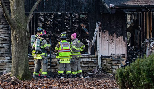 Firefighters look for hotspots Monday morning at N79W24734 Plainview Road in the Town of Lisbon after a fire destroyed the single family ranch home on Sunday evening Dec. 22, 2019.
