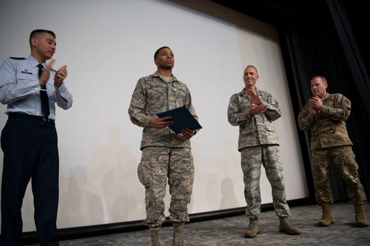 Airman 1st Class Vashon Williams, 42nd Operational Medical Readiness Squadron dental assistant, receives applause during a ceremony in which he is presented with the Air Force Achievement Medal December. 19, 2019, at Maxwell Air Force Base.