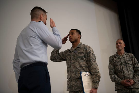 Col. Patrick J. Carley, 42nd Air Base Wing commander, exchanges a salute with Airman 1st Class Vashon Williams, 42nd Operational Medical Readiness Squadron dental assistant, during a ceremony December. 19, 2019, at Maxwell Air Force Base.