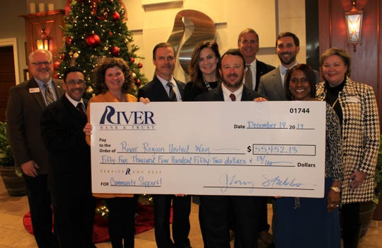 River Bank & Trust employees present a donation to the River Region United Way.