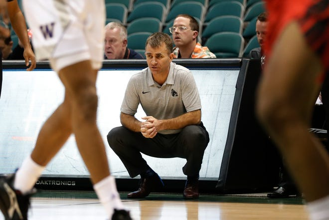Ball State head coach James Whitford watches his team take on Washington during the first half of an NCAA college basketball game Sunday, Dec. 22, 2019, in Honolulu. (AP Photo/Marco Garcia)