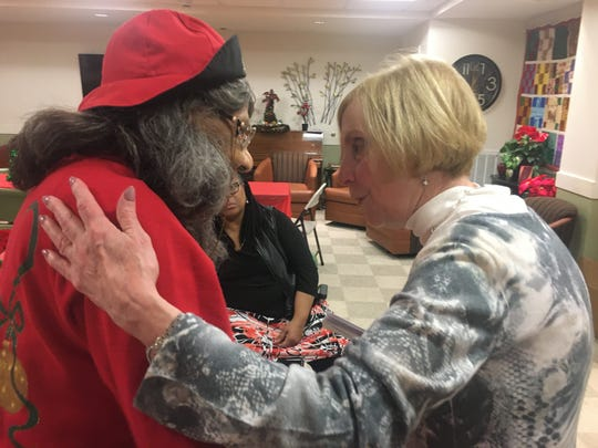 Senior Georgia Davis, 91, and Kathy Strunk, member of Historic Franklin Presbyterian Church, converse at the Reddick Senior Residence Christmas party.