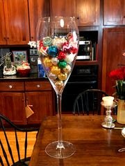 Ms. Cheap says a favorite find was a giant wine glass that serves as an all season centerpiece on her kitchen table.
