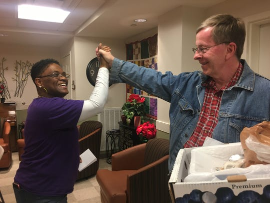 Tracye Tucker, co-founder of Daughters of the King nonprofit, and Robert Smith, volunteer at Historic Franklin Presbyterian Church congregate at the recent Christmas party at Reddick Senior Residence in Franklin.