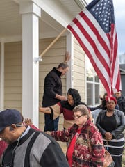 Chris Beck blesses Tranita's new home in Fairview during the HFHWM dedication ceremony on Sat., Dec. 14, 2019.