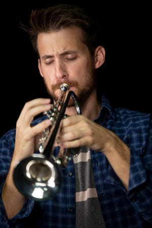 Ansel Norris, assistant principal trumpet with the Naples Philharmonic, performs Wanderer's Nightsong by Franz Schubert on Friday, December 20, 2019.