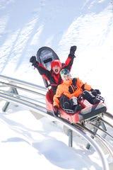 Riders enjoy the mountain coaster at Okemo.