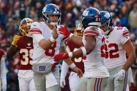 Dec 22, 2019; Landover, Maryland, USA; New York Giants quarterback Daniel Jones (8) celebrates with Giants running back Saquon Barkley (26) after connecting on a touchdown pass against the Washington Redskins in the second quarter at FedExField. Mandatory Credit: Geoff Burke-USA TODAY Sports
