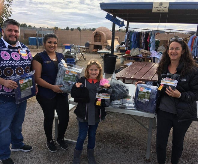 Pictured in the photo are Arnold Diaz, Manager of the Valley Wal-Mart, a Wal-Mart partner, Lillian, and Nicole Martinez, Mesilla Valley Community of Hope Executive Director.