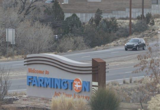 A car drives, Monday, Dec. 23, 2019, on New Mexico Highway 516 leaving Farmington.