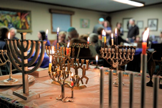 Menorahs are pictured on a table, Sunday, Dec. 22, 2019, on the first night of the Jewish celebration of Hanukkah at Congregation Har Shalom in Durango, Colorado.