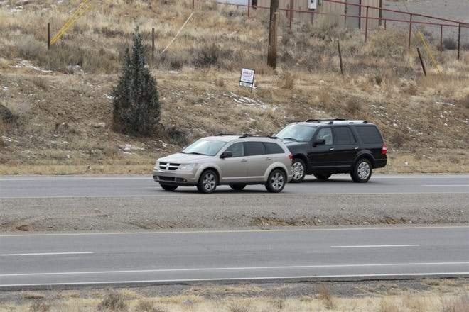 A car passes another car while driving, Monday, Dec. 23, 2019, on New Mexico Highway 516 near the turnoff to Lake Farmington.