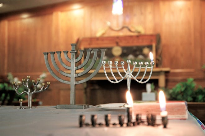 Candelabras called menorahs sit on the first night of the Jewish celebration of Hanukkah at Congregation Har Shalom in Durango, Colorado, on Dec. 22, 2019.