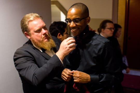 Kenneth Bloomfield  helps Herbert Washington, the director of the Phoenix Boys Choir, fix his tie before the choir's holiday concert Dec. 14 at Camelback Bible Church.