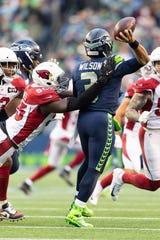 Dec 22, 2019: Seattle Seahawks quarterback Russell Wilson (3) throws the ball before being hit by Arizona Cardinals linebacker Chandler Jones (55) during the second half at CenturyLink Field. Arizona won 27-13.