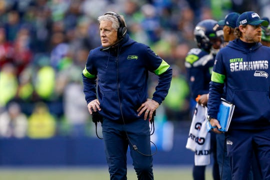 Seattle Seahawks head coach Pete Carroll waits for a replay review Dec. 22 during the second quarter against the Arizona Cardinals at CenturyLink Field in Seattle.