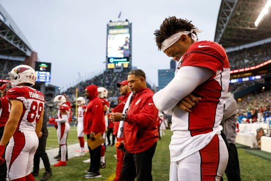 Dec 22, 2019; Seattle, Washington, USA; Arizona Cardinals quarterback Kyler Murray (1) stands on the sideline following a third quarter injury against the Seattle Seahawks at CenturyLink Field. Mandatory Credit: Joe Nicholson-USA TODAY Sports