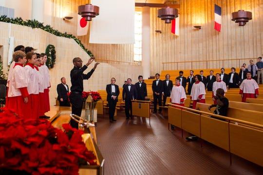 Herbert Washington, the artistic director of the Phoenix Boys Choir, runs a dress rehearsal before the final show of the season Dec. 14 at the Camelback Bible Church.
