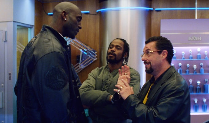 Kevin Garnett makes a deal with Adam Sandler as LaKeith Stanfield in a scene from 'Uncut Gems.'